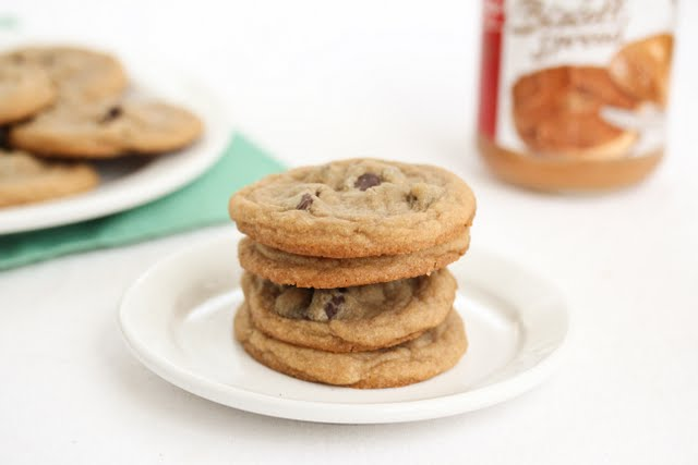 a stack of cookie spread cookies on a plate