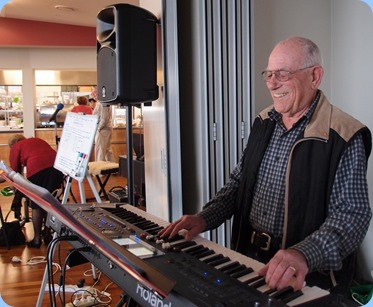 Our Treasurer, Laurie Conder, playing his Roland BK-9. Photo courtesy of Dennis Lyons.