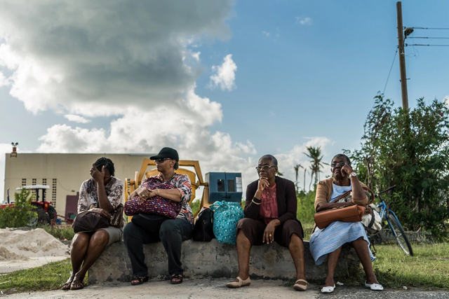 Barbudans wait for a plane to head back to Antigua after attending the Thanksgiving service in Barbuda, 16 January 2018. Photo: Salwan Georges / The Washington Post