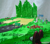 Moving to kansas Groom's cake with Wizard of Oz characters, edible Emerald City, Wicked witches feet, cars, motorcycles and u-haul 4