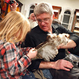 Rich Bernard of Lakeville holds a wing of a Red Tail Hawk so his three year-old grand-daughter Sydney Bernard of Rochester can observe during the Birds of Prey program at the Marion Natural History Museum Friday night. Photo credit: Michael Smith.