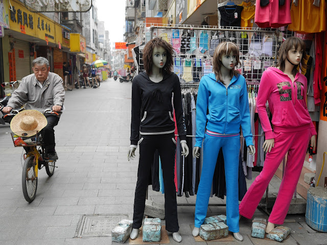 mannequins and man on a bike in Yangjiang, China