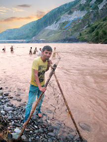Collecting woods in Jheum River.