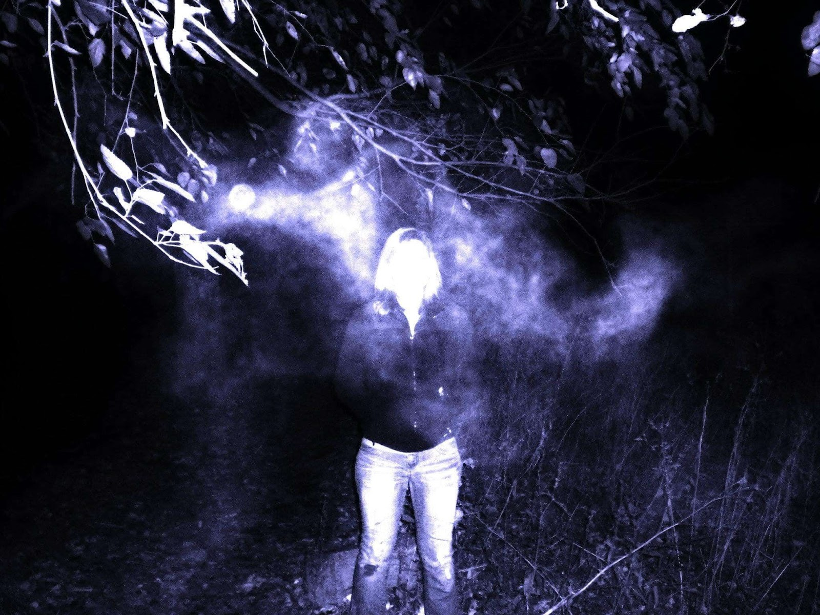 Facebook July 11, 2019 Kenneth Deheve  A few years ago, my friends and I visited one the most haunted places in the country, Bachelors Grove, and we took a photo of one of our friends, Heather Robson, standing under a tree. When we looked back at the photo, there was a suddenly a strange fog that appeared that was not there when we took the photo. We played with the contrast a little bit in the second photo. Still have no idea where it came from but this fucked us up good.  (Contrasted Photo)