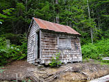 Sadly, this cabin has a little time left before the bank beneath it erodes to the point where the cabin falls over into the Paradise River.