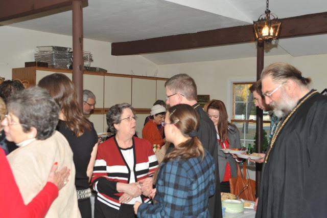 Parishioners and visitors mingle and enjoy fellowship.