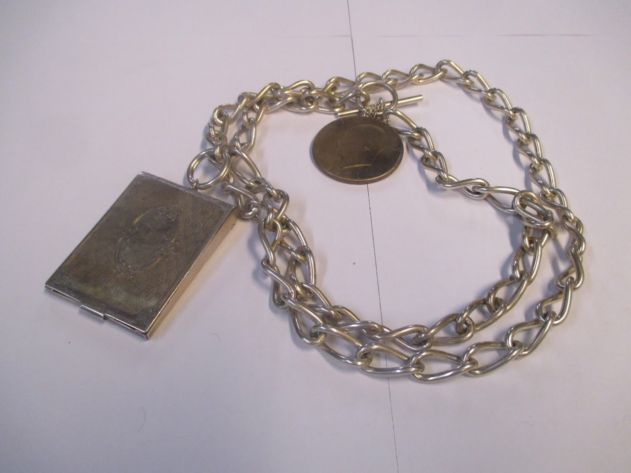 Sterling SIlver Necklace and Holder with Metal Coin