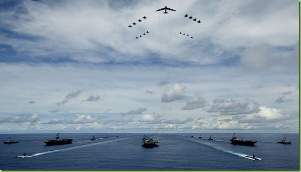 USS KITTY HAWK, at sea - A U.S. Air Force B-52 leads a formation of Air Force and Navy F-16, F-15, and F-18 aircraft over the USS Kitty Hawk (CV 63), USS Nimitz, and USS John C. Stennis Strike Groups during Valiant Shield's photo exercise Aug.14 (Guam time). The forces participated in Valiant Shield, the largest joint exercise in the Pacific this year. Held in the Guam operating area, the exercise includes 30 ships, more than 280 aircraft and more than 20,000 service members from the Navy, Air Force, Marine Corps, and Coast Guard. (U.S. Navy photograph by Mass Communication Specialist 2nd Class Jarod Hodge)