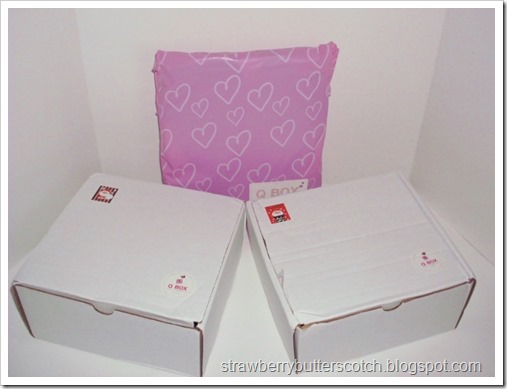 Three cute Q Box boxes, waiting to be opened.