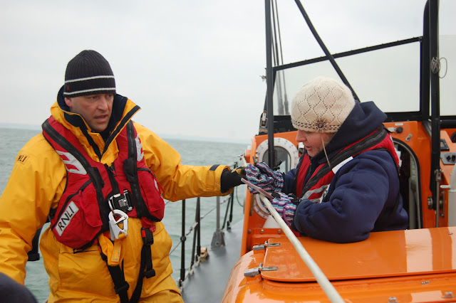 Crew Member Natalie Warren filling in the casualty care cards with Deputy Lifeboat Medical Adviser Dr John Turner looking on Photo: RNLI Poole/Dave Riley