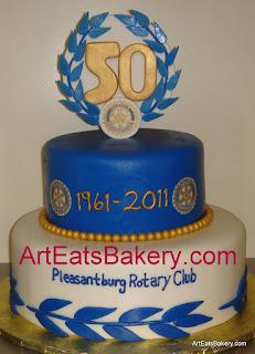 Pleasentburg Rotary Club two tier gold, blue and white fondant custom 50th birthday cake.