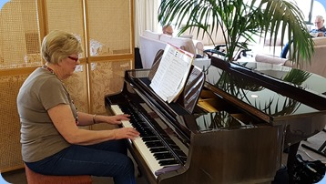Kay Boyes playing the Schimmel mini-grand piano.