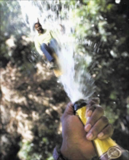 THE TIMES PRODUCT TEST - Champagne with Tumisho Masha - Tumisho Masha gets shot out of a champagne bottle. 04 December 2008. Picture & Manipulation: DANIEL BORN