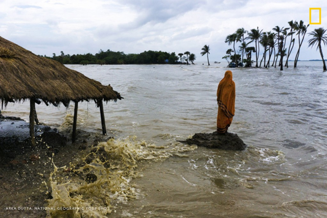 Disappearing homes, 17 September 2016: Due to sea-level rise, many islands in the Ganges Delta region of West Bengal, India, are facing fast erosion. The island of Mousuni is one such island, which is sinking with each passing tide. Homes and lands are sinking at a steady rate, and people are staring at a bleak future, in which the probability of them becoming climate refugees looms large. Photo: Arka Dutta / National Geographic Your Shot