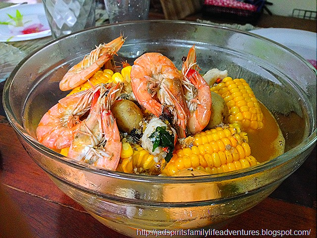 Seafood with corn and potatoes cooked shabu-shabu style