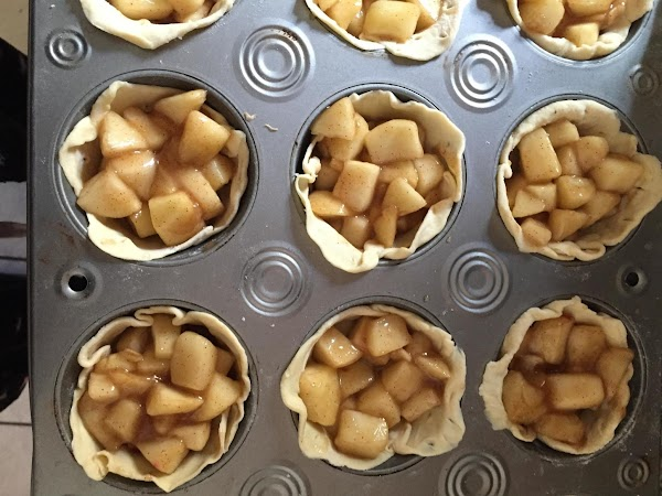 Fill pastry lined tins evenly with apple mixture. Chop up the soft caramels in...