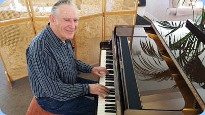 Roy Steen playing the Schimmel mini-grand piano.