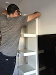 Attaching the shelf at the top to the wall to secure it