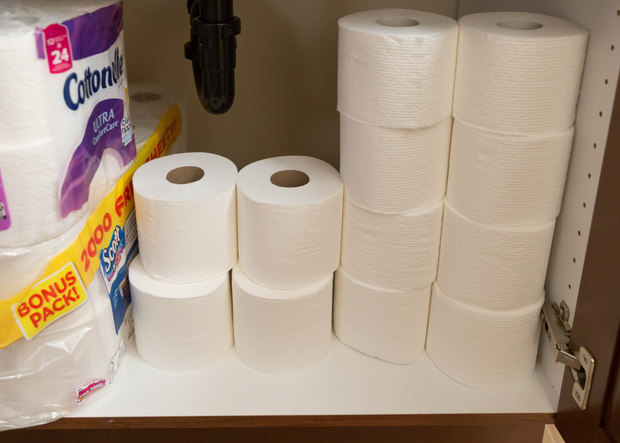 photo of toilet paper in a cabinet