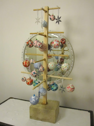 IKEA metal Christmas tree that displays ornaments. Perfect for balconies or outside decorations or anywhere. Stands 39