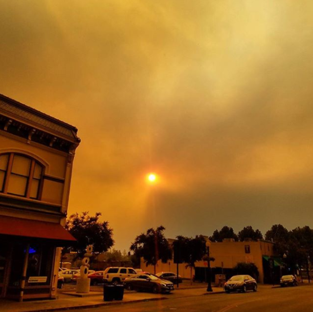 The sun shines orange through smoke from wildfires in downtown Napa, California, 9 October 2017. Photo: Fishify / Instagram