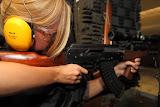 Isabell shooting the Kalashnikov (© 2010 Bernd Neeser)