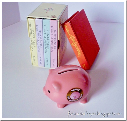 Tiny books and a itty bitty piggy bank.  Perfect size for a doll.