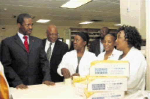 MAKING ROUNDS: KwaZulu-Natal MEC for health Sibongiseni Dhlomo listens to Gladys Shazi and Zippora Gumede's problems at the Addington Hospital pharmacy. PiC: THEMBA MNGOMEZULU. 14/07/2009. © Sowetan.