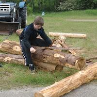 Skinning cedar logs