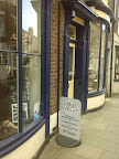 twin shop frontage of vintage jewellery repairer with sign