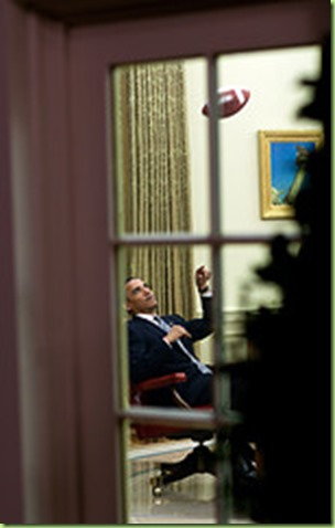 "April 23, 2009 ""The President throws a football to one of his aides before a meeting in the Oval Office."" (Official White House photo by Pete Souza)  This official White House photograph is being made available only for publication by news organizations and/or for personal use printing by the subject(s) of the photograph. The photograph may not be manipulated in any way and may not be used in commercial or political materials, advertisements, emails, products, promotions that in any way suggests approval or endorsement of the President, the First Family, or the White House."