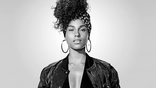 Alicia Keys Shows Off Her Fela Anikulapo Kuti Music Collection (Photos)