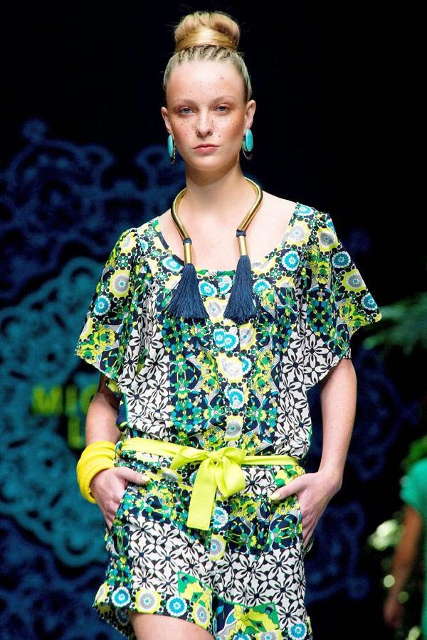 A model presents a creation by designer Michelle Ludek, on the second day of the Cape Town Fashion Week, on July 25, 2014, in Cape Town.