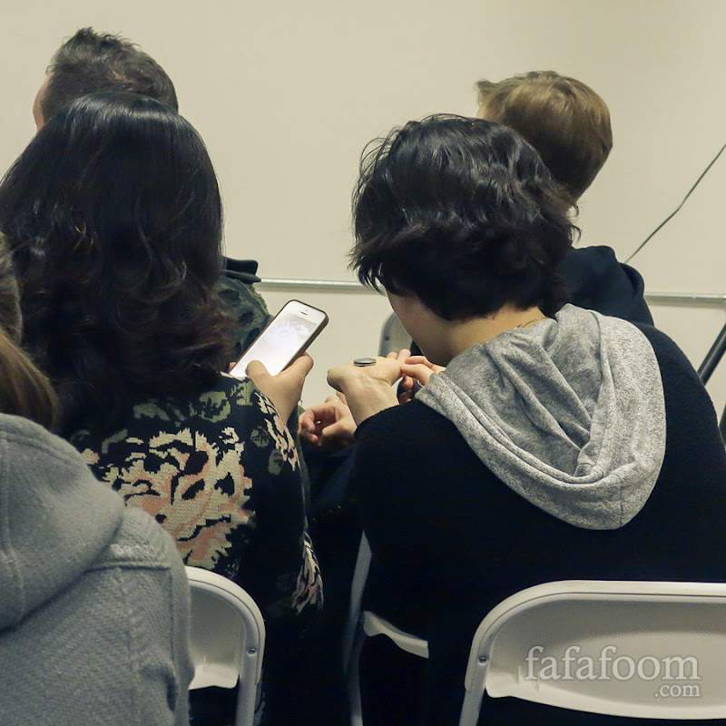 Audience members checking out Misfit Wearables' Shine