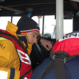 Crew Member Oli Mallinson overlooking the chart table on exercise on Sunday 20 January 2013 Photo: RNLI Poole/Dave Riley