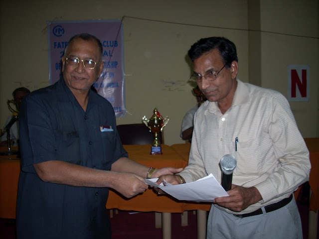 2. K Nageswara Rao receiving a Prize from Srikishanlal Sarma EC Member