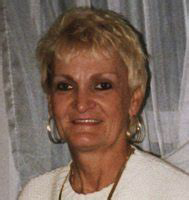 Margaret Anderson, an older caucasian woman with short bleach blonde hair with dark eyeliner smiling at the camera | Momma Loves True Crime | True Crime