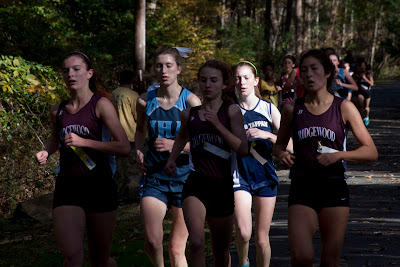 Erica Canas of Old Tappen sitting very comfortable in a pack of girls she would beat midway thru the race. Caroline Davidson, Laura Weisberger and Hanako Shigenobu of Ridgewood. #5