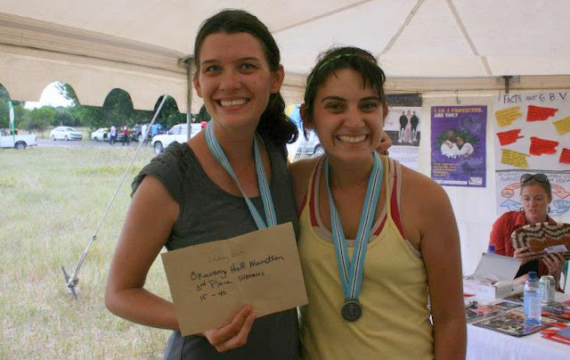 PCVs proudly show their race winnings and medals in an expo booth