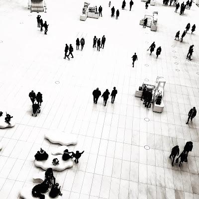 Overhead view of people walking the floor of the Oculus