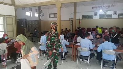 Babinsa Ramil 01/Bantul Laksanakan Pengamanan Penyaluran  BST