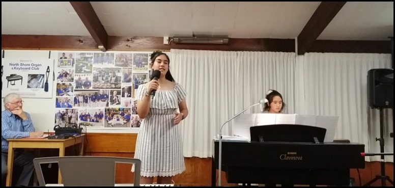Ashley singing and accompanied by Hana Tani on the Yamaha Clavinova CVP-509. Photo courtesy of Dennis Lyons.