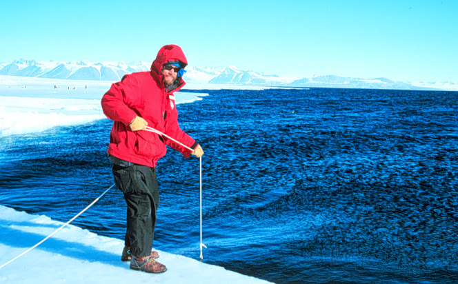 Craig Wolf checks the CTD calibration at the sea ice edge, 1997.