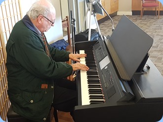 George Watt playing the Village's Yamaha Clavinova CVP-709