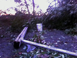 You can see the broken streetlight in the middle and the fallen tree is on the right of the photo. This cell phone picture doesnt quite capture the destruction well enough but it should give you an idea. Photo taken on December 15, 2006.