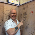 Jason Tharpe adds his name and doodle to the wall of fame