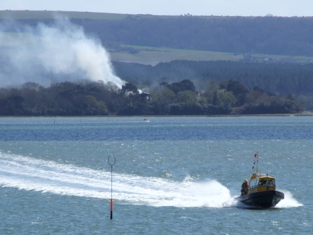 20 April 2012 - Pilot boat Vanguard returns firefighters to Poole port from Green Island (Photo credit: Kevin Mitchell, Maritime Images)