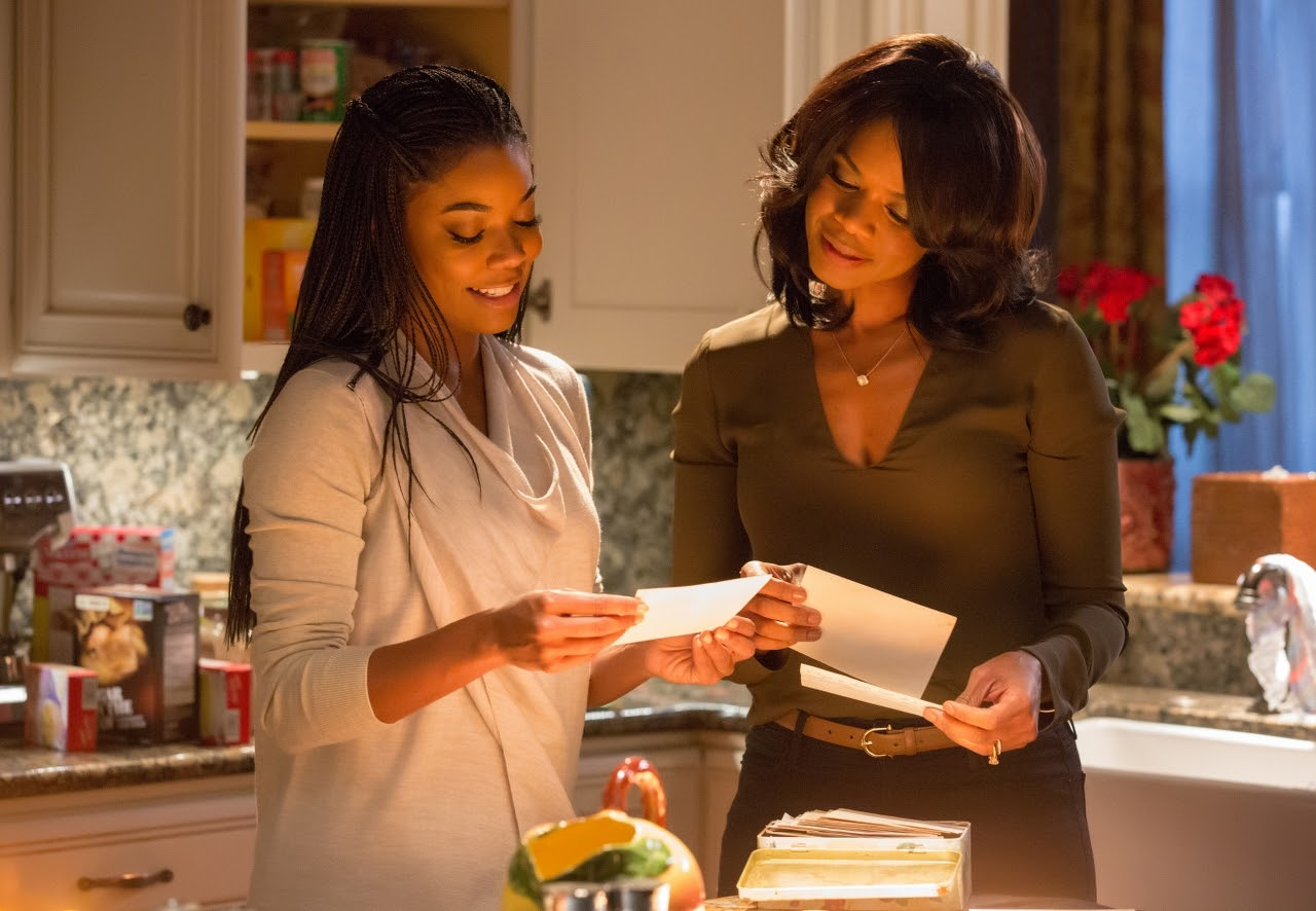 Gabrielle Union and Kimberly Elise in ALMOST CHRISTMAS. (Photo by Quantrell D. Colbert / courtesy of Universal Pictures).