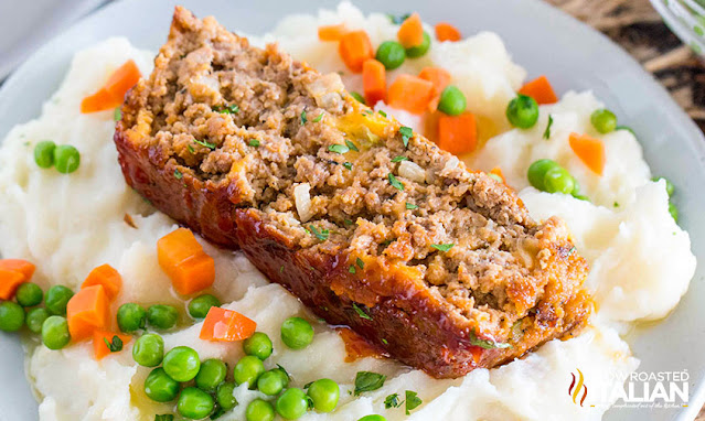 Cracker Barrel Meatloaf on mashed potatoes and veggies