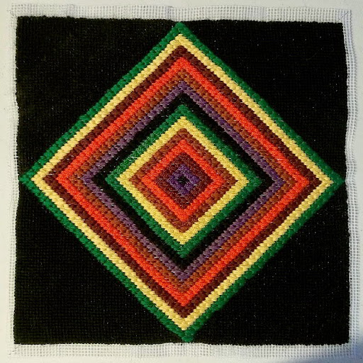 Diamond 4-way bargello in floss with tent stitched background